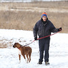 James Bentley of Westford, with his boxer Rocky, heads for his car after a walk around the cranberry bog (no longer farmed as of 2017) on Curve Street in Carlisle. It's a very popular dog-walking loop. (SUN/Julia Malakie)