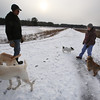 Dogs and their owners walk around the cranberry bog (no longer farmed as of 2017) on Curve Street in Carlisle. It's a very popular dog-walking loop. Jay Patrick of Carlisle, left, and Debbie Kritzler of Chelmsford, right, with her Irish Shortie Jack Russell terrier Willie, and border terrier Penny, right. SUN/Julia Malakie)