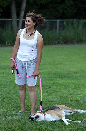 Features at Chelmford Dog Park. Angela Bedoya of Lowell waits for her hound mix, Gabby, to rest after running around in the 90 degree heat. (SUN/Julia Malakie)