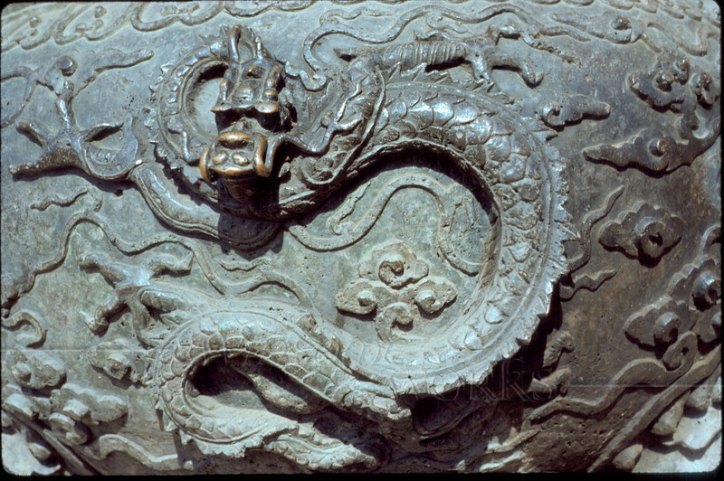 Dragon carved on a large ancient pot