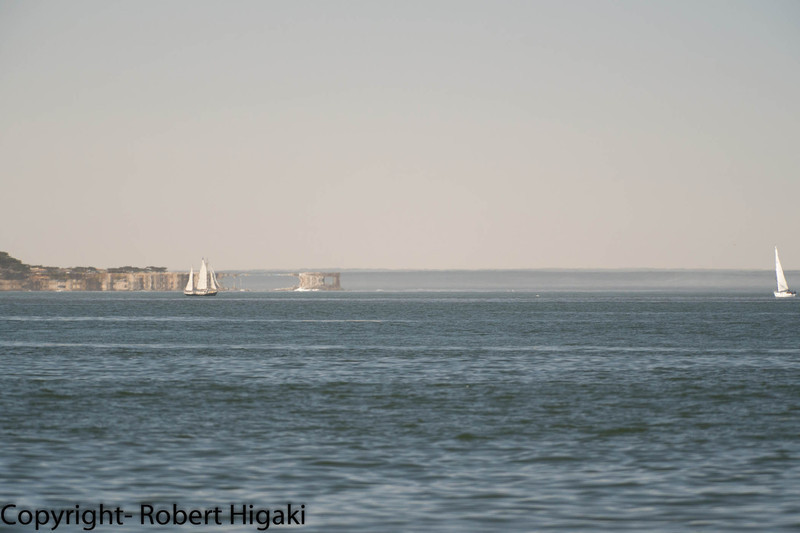 this is a mirage! look closely at the rock formations to the right of the sailing ship.( inverted reflection)