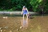 While cooling off at the Rock Bottom Weekend, Little was wading in the stream and got too deep and started floating downstream - Cindy had to go rescue her - Photo by Pat Bonish