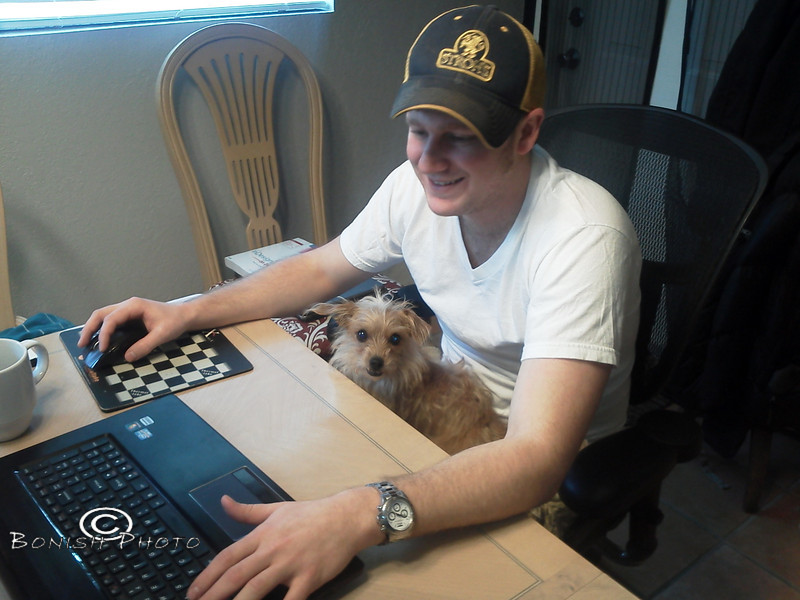 Little working with Adam Mularski while he works on the layout of the Happiness Is Book - Photo by Pat Bonish