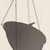 Shadow of hanging pot with dove's tail showing<br /> .