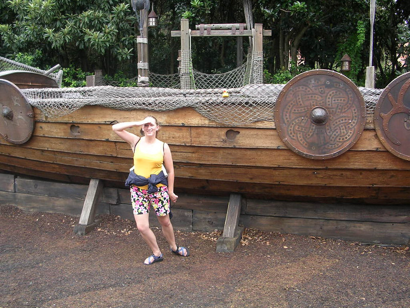 Duck (in the rigging) and me outside the Viking Longboat.  I was doing a sailor pose and he just didn't want anything to do with me.