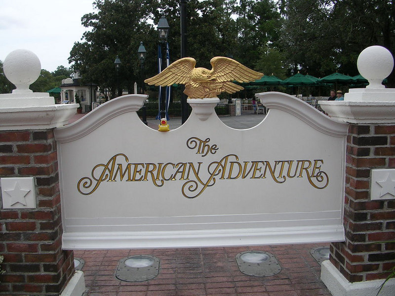 Duck outside the American Adventure in Epcot.  He thinks that he should replace the Eagle on the sign.