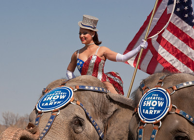 Gleice DeSouza rides atop the lead elephant during the Ringling Bros. and Barnum & Bailey annual pachyderm parade. The famous elephants stand in front of the US Capitol to kick off their showing of BARNUM 200SM, a 200-year anniversary show. The pachyderm parade took place in Washington DC on March 22, 2011.  (Photo by Jeff Malet)