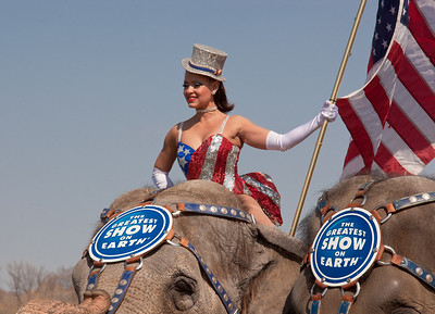 Gleice DeSouza rides atop the lead elephant during the Ringling Bros. and Barnum & Bailey annual pachyderm parade. The famous elephants stand in front of the US Capitol to kick off their showing of BARNUM 200SM, a 200-year anniversary show. The event took place in Washington DC on March 22, 2011.  (Photo by Jeff Malet)
