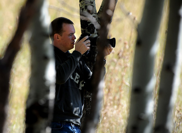 """Mike Judy of Denver positions himself to photograph elk in Moraine Park at RMNP on Friday.<br /> For more photos and a video, go to  <a href=""""http://www.dailycamera.com"""">http://www.dailycamera.com</a><br /> Cliff Grassmick / September 24, 2010"""