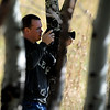 "Mike Judy of Denver positions himself to photograph elk in Moraine Park at RMNP on Friday.<br /> For more photos and a video, go to  <a href=""http://www.dailycamera.com"">http://www.dailycamera.com</a><br /> Cliff Grassmick / September 24, 2010"