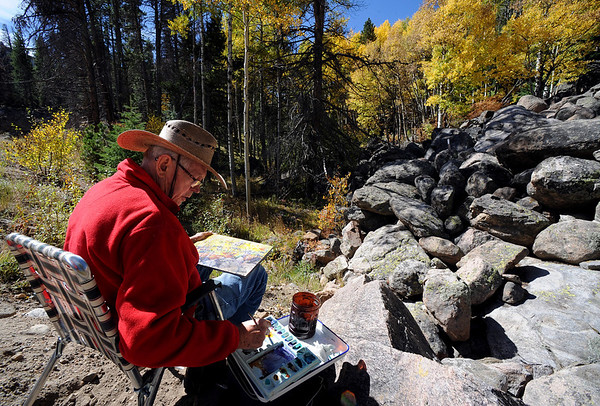"Dennis Reinke, an artist from Estes Park, paints an aspen scene near Bierstadt Lake Trailhead in Rocky Mountain National Park on September 24, 2010.<br /> For more photos and a video, go to  <a href=""http://www.dailycamera.com"">http://www.dailycamera.com</a><br /> Cliff Grassmick / September 24, 2010"