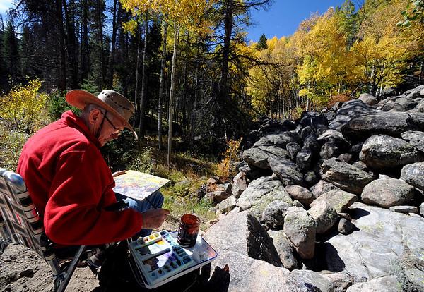 "Dennis Reinke, an artist from Estes Park, paints an aspen scene near Bierstadt Lake Trailhead in Rocky Mountain National Park on September 24, 2010.<br /> For more photos and a video, go to  <a href=""http://www.dailycamera.com"">http://www.dailycamera.com</a><br /> Cliff Grassmick / September 24, 2010"