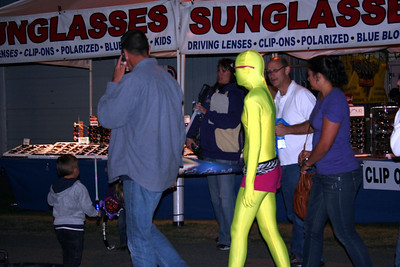 All the odd people come out to the fair. For some reason this lady wanted to ware a bright yellow body sute to the fair. What was she thinking?  That is one of the reasons I love going to the fair. Not only to see the animals but also the odd wildlife that comes to the fair. 2010