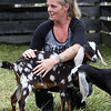 Opening of Indian Valley Goats Dairy at Krochmal Farms in Tewksbury. Kelly Lynch of Teague, Texas, formerly of Hudson, N.H., a friend of Jen Nagle, with Nubian goat calf Mini Ray-Ray.(SUN/Julia Malakie)