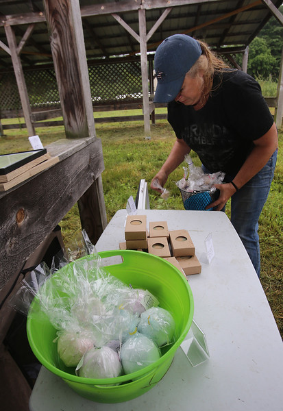 Opening of Indian Valley Goats Dairy at Krochmal Farms in Tewksbury. Jen Nagle sets out her soap and bath products made with goats' milk. (SUN/Julia Malakie)