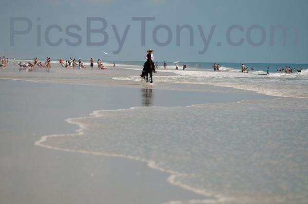 Woman Riding Horse on Hammock Beach, FL on Jul 10, 2014