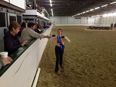 Jordan running her vistory pass instead of riding on her horse.