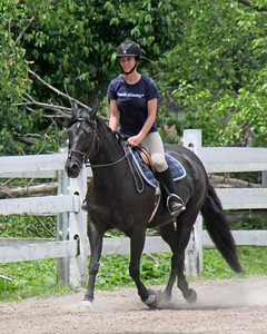 Beautiful woman on beautiful horse at Nassau Equestrian Center.