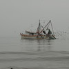 Shrimp boat in early morning fog