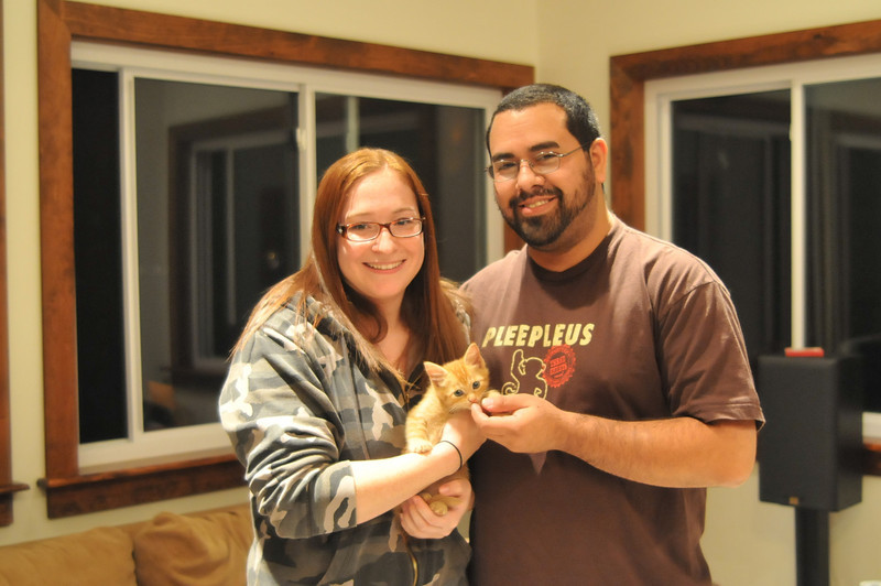 Alicia and her boyfriend, adopters for Flan; the orange tabby.