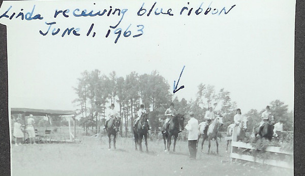 receiving the blue ribbon in the Walk-Trot class in 1963, outside of Augusta GA