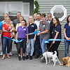 Lakefront Dog Retreat owner Lena Grosser cuts the ribbon at Friday's grand-opening celebration in Leominster.