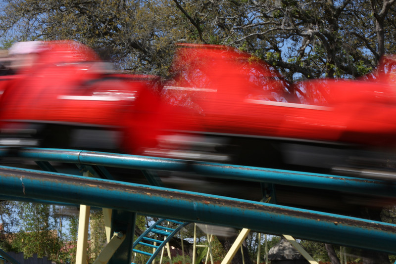 I slowed down the shutter speed so that the coaster would blur adding the feeling of speed to the photo.