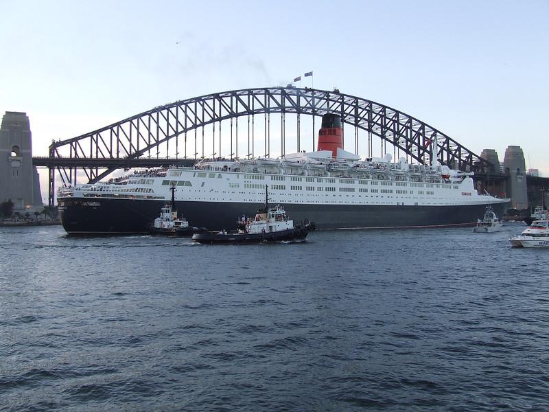 The Queen Elizabeth 2 against the Sydney Harbor Bridge.
