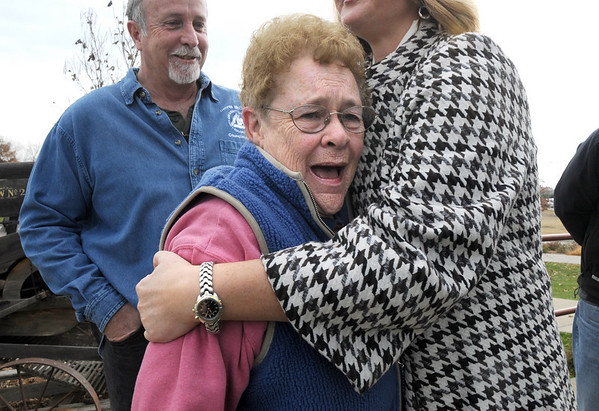 Peggy Atikinson, the curator of the Depot Hill Museum, cries with joy as she watches the move of Shep the Turnpike Dog's grave from the intersection of Hwy. US 36 and Hwy. 121 to the Depot Hill Museum on Wednesday.<br /> October 14, 2009<br /> Staff photo/David R. Jennings