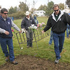 Broomfield Parks employees Rick Sedbrook, left, Justin Kent, and Bill Cooksey carry the rebar fence for Shep the Turnpike Dog to the Depot Hill Museum during Wednesday's  move of Shep's grave from the intersection of Hwy. US 36 and Hwy. 121.<br /> October 14, 2009<br /> Staff photo/David R. Jennings