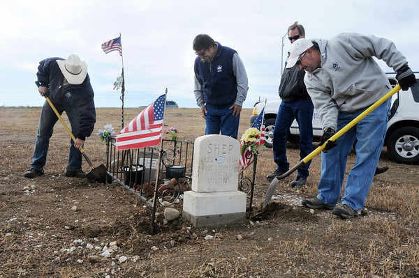 Broomfield Parks employees Justin Kent, left, Rick Sedbrook, Bill Cooksey, and Jeff Kissinger work on moving the grave of Shep the Turnpike Dog from the intersection of Hwy. US 36 and Hwy. 121 to the Depot Hill Museum on Wednesday.<br /> October 14, 2009<br /> Staff photo/David R. Jennings