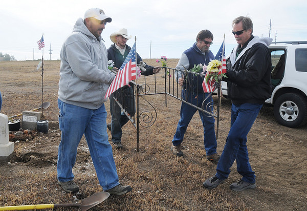 Broomfield Parks employees Jeff Kissinger, left, Justin Kent, Rick Sedbrook and Bill Cooksey carry the rebar fence for Shep the Turnpike Dog during the move of Shep's grave from the intersection of Hwy. US 36 and Hwy. 121 to the Depot Hill Museum on Wednesday.<br /> October 14, 2009<br /> Staff photo/David R. Jennings