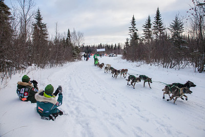 SLED DOGS 9665  Erin Redington - Knik, AK - Stage One Start in Grand Portage  2014 Gichigami Express Sled Dog Race - Cook County, MN