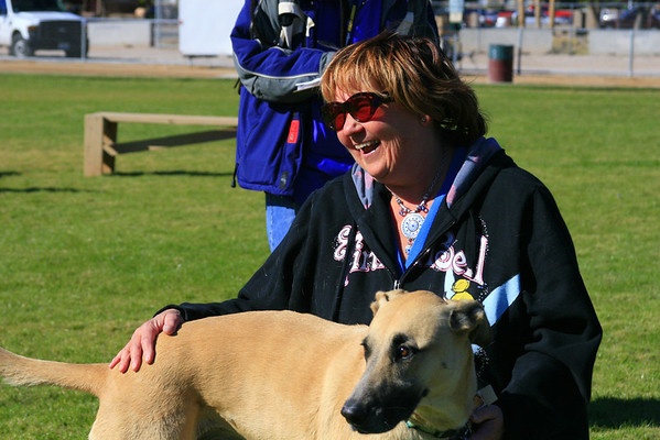 Stiltzskin gives owner Maria Krisher a good laugh during Strut Your Mutt's Howl at the Moon contest.