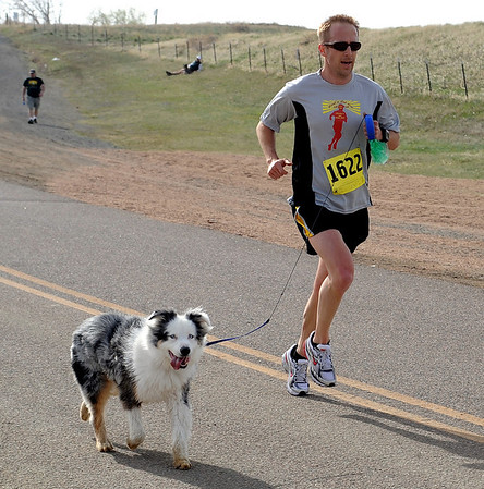 "Eric Schwartz and his dog Blue won the race for the seventh time in a row.<br /> The annual Canine Classic race and carnival was held at the Boulder Reservoir on Sunday.<br /> For more photos and a video, go to  <a href=""http://www.dailycamera.com"">http://www.dailycamera.com</a>.<br /> Cliff Grassmick / April 18, 2010"