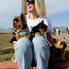 "Kimberly Brayman of Longmont, waits for the race with Walter, Finnigan, and Lily.<br /> The annual Canine Classic race and carnival was held at the Boulder Reservoir on Sunday.<br /> For more photos and a video, go to  <a href=""http://www.dailycamera.com"">http://www.dailycamera.com</a>.<br /> Cliff Grassmick / April 18, 2010"
