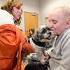 Bob Bigwood gets some love from therapy dog Gronk, from TheraPAWS, while held by owner Cindy Staveley at the Arc of Opportunity in Fitchburg on Wednesday afternoon. SENTINEL & ENTERPRISE / Ashley Green