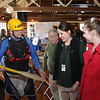Gene Baker, a member of the Kayak club, Keelhaulers, discussing paddle designs to Catherine Schaefer, in red jacket, Jannah Wilson, from Lorain Metroparks and Rober Blair, another Keelhauler volunteer.