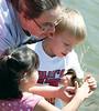 Laura, Elijah and Elvira hold a baby duck