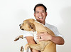 Man holding a Dogand Laughing