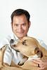 Happy Man holding a Dog