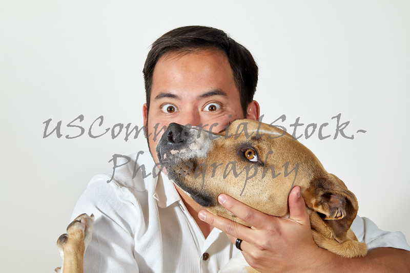 Man with Dog's head against his Cheek