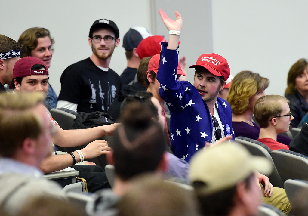 . A Donald Trump supporter, who refused to give his name, waves bye as student protesters walk out as Ann Coulter speaks during an event hosted by a CU Turning Point chapter on Thursday at the Cristol Chemistry and Biochemistry building in Boulder. For more photos of the event go to dailycamera.com Jeremy Papasso/ Staff Photographer 03/21/2018