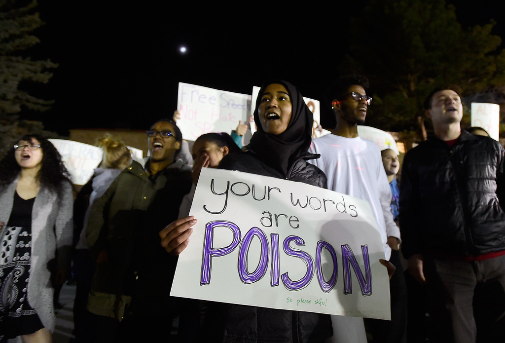 . University of Colorado junior Heraa Hashmi holds a sign and protests with others as Ann Coulter speaks during an event hosted by a CU Turning Point chapter on Thursday at the Cristol Chemistry and Biochemistry building in Boulder. For more photos of the event go to dailycamera.com Jeremy Papasso/ Staff Photographer 03/21/2018