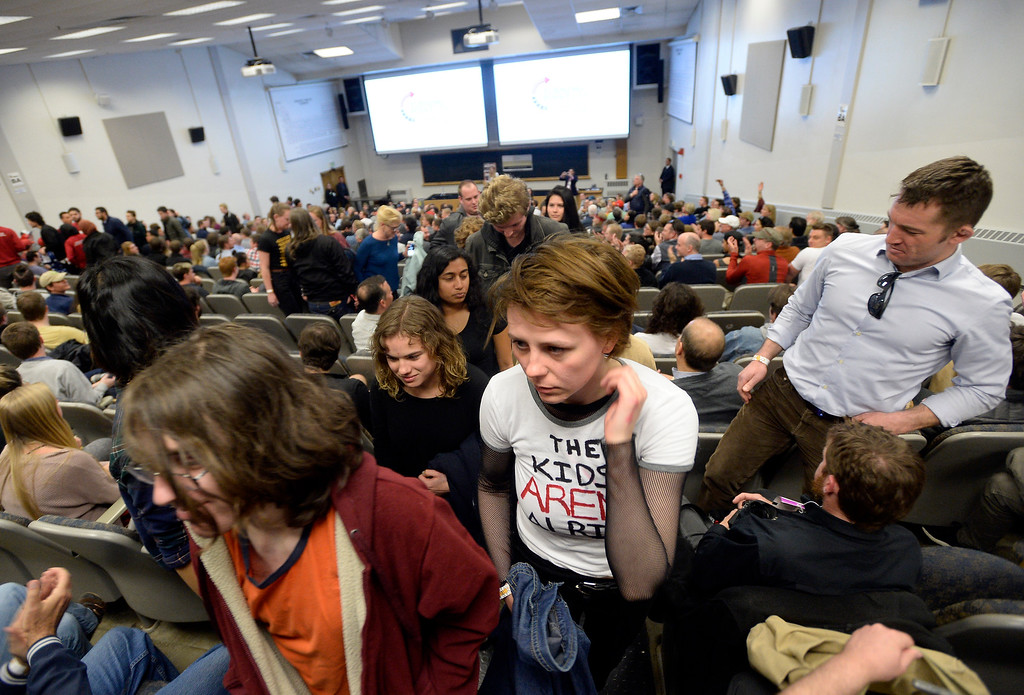 . Student protesters walk out as Ann Coulter speaks during an event hosted by a CU Turning Point chapter on Thursday at the Cristol Chemistry and Biochemistry building in Boulder. For more photos of the event go to dailycamera.com Jeremy Papasso/ Staff Photographer 03/21/2018