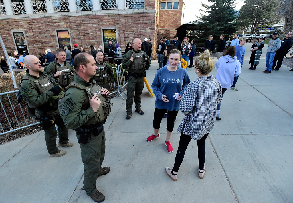 . Police officers talk with students, who asked not to be identified, as they wait to hear Ann Coulter speak during an event hosted by a CU Turning Point chapter on Thursday at the Cristol Chemistry and Biochemistry building in Boulder. For more photos of the event go to dailycamera.com Jeremy Papasso/ Staff Photographer 03/21/2018