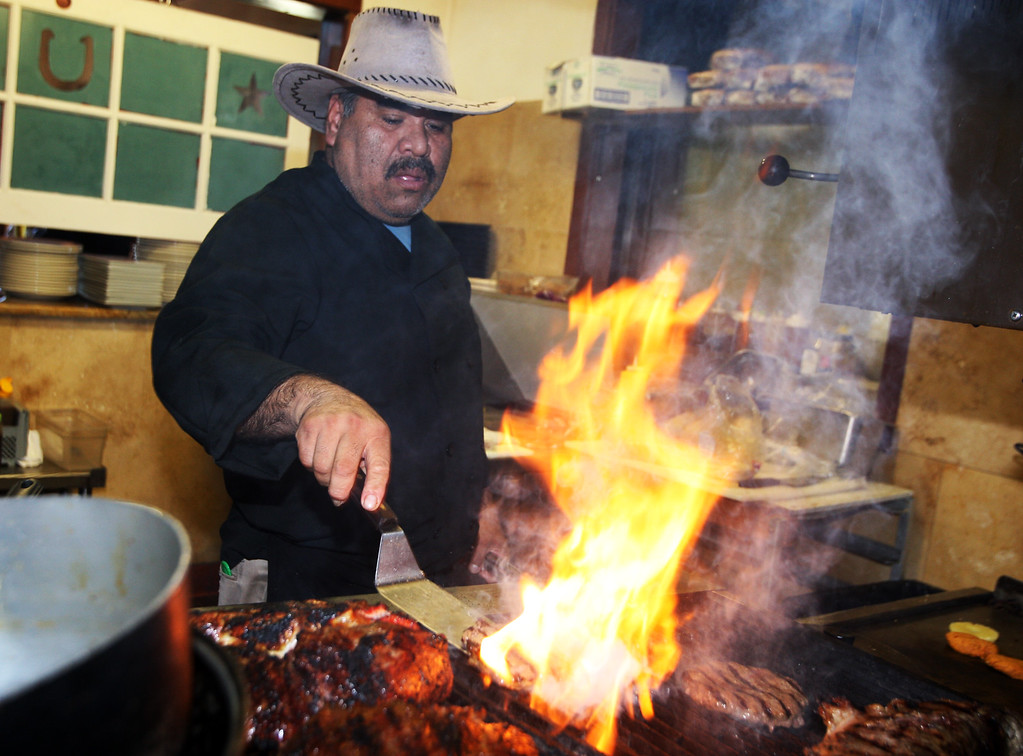. Cowboy Grill moves into Felton Guild-Oak Tree Ristorante.  Francisco Castillo chef, yam cakes, pork salad Annie  (Dan Coyro -- Santa Cruz Sentinel)