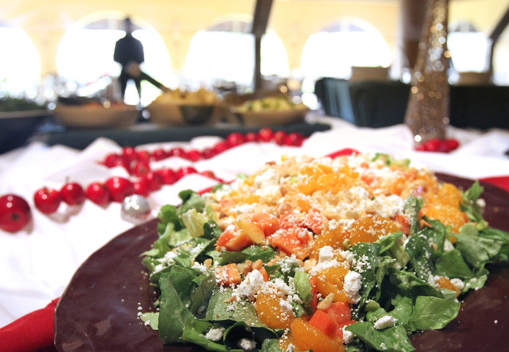. Butter lettuce with cranberries, feta, mandarin oranges, macadamia nuts and a persimmon vinaigrette at the Chaminade Sunday brunch buffet. (Shmuel Thaler -- Santa Cruz Sentinel)