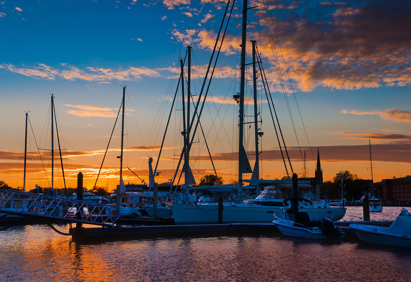 Sunset over boats in a marina in Annapolis, Maryland.