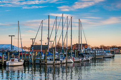 Sailboats in a marina at sunset along the waterfront in Annapolis, Maryland.